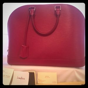 Louis Vuitton Alma GM Epi handbag in Fuchsia